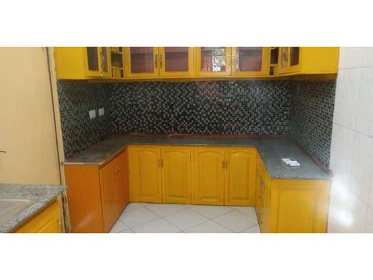 3bed house at mikocheni regent  on main rd i deal for office  with nice price image 13