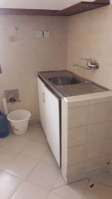 One self contained room for rent image 4