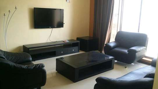 a 3bedrooms fully furnished appartment are avaiable for rent at msasani with a very cool paved road street image 1