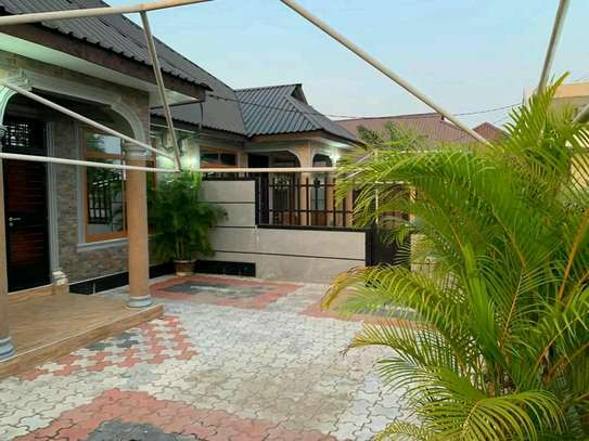 a 3bedrooms standalone is for rent at kunduchi image 2