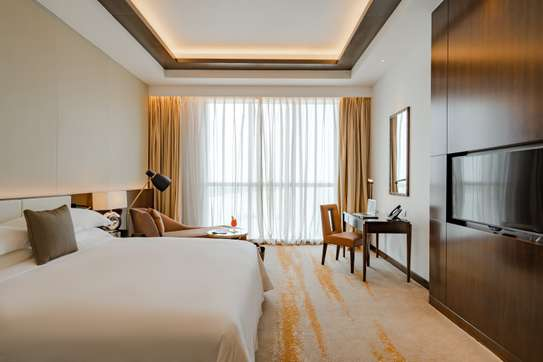 Luxury One Bedroom Apartment at Johari Rotana Hotel image 2