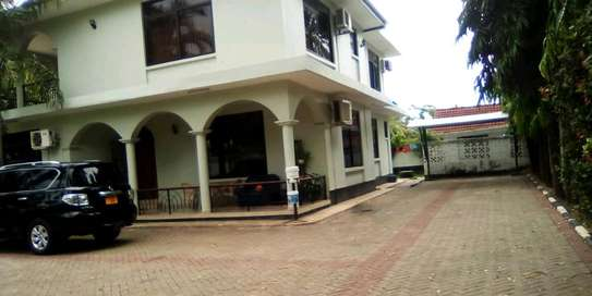 a 4bedrooms house is for sale at mbezi beach with a very cool street image 3