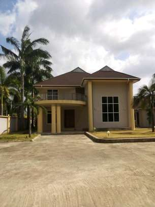 a 4bedrooms and outside 2separate big rooms with a kitchen bangalow at mbezi beach is now available for rent image 1