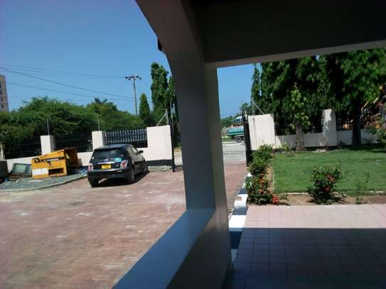 3bed house for office  along main rd at mikocheni a image 9