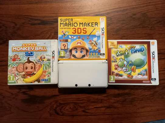 Slightly Used Nintendo 3DS Comes With Super Mario Maker, Super Mario 3D Land, New Yoshis Island and Super Monkey Ball 3D image 1