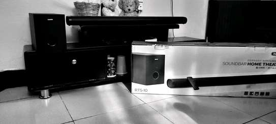 a soundbar with a very strong bass, used only 3months it has its 1year warrant image 1