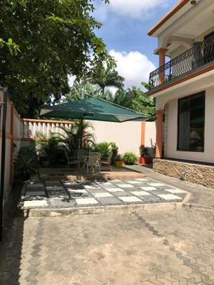 a 4bedrooms bungalow is for sale at mbezi beach very cool street image 3
