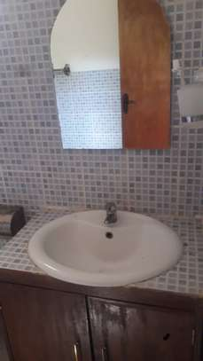 One self contained room for rent image 5