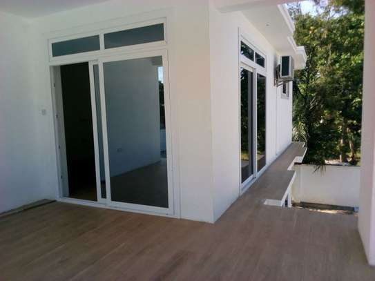 4bed room ensuite at mbezi beach with big compound next to the beach $15000 image 15