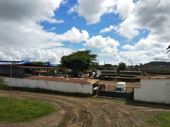 Large Walled Plot with Warehouses in Njiro image 2