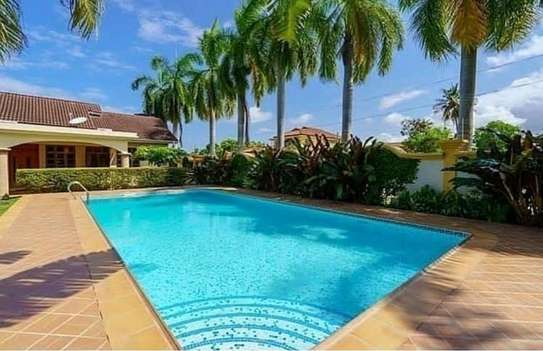 a 2bedrooms fully furnished villas in MBEZI BEACH with a very cool neighbour hood is now available for rent image 1