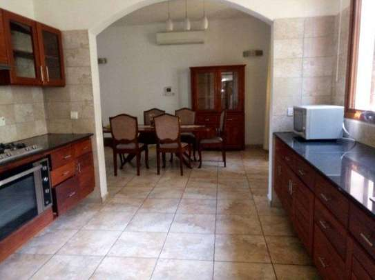 4bed house along main rd kawe beach $1300pm i deal for office cum residance image 5