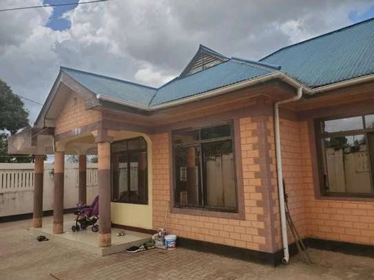 Two house for sale at kinyerezi ilala dar-es salam each have independent luku contains 3bedrooms dining,siting rooms ,kitchen with 3business frems and this is the corner plot  at price of tzsh 170m afordable and negotiable image 2