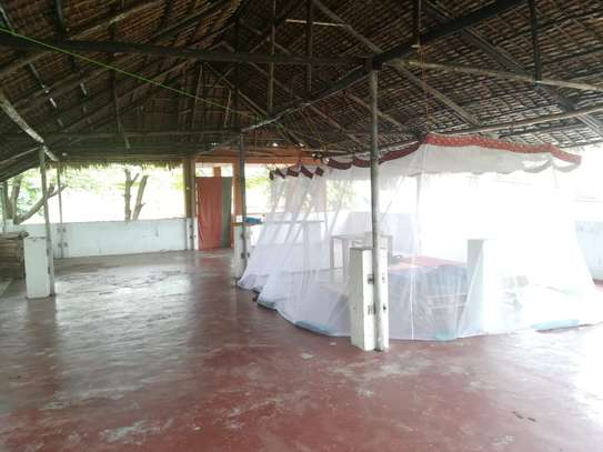 3 bed room {2master} stand arone house for rent at msasani near BBQ with a tarrance and makuti roof  $1000pm image 2