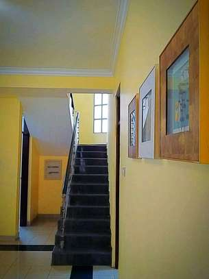 MIKOCHENI  SHOPPERS PLAZA..a 4bedrooms  VILLA is available for rent at mikocheni cool street u can find in tz image 6