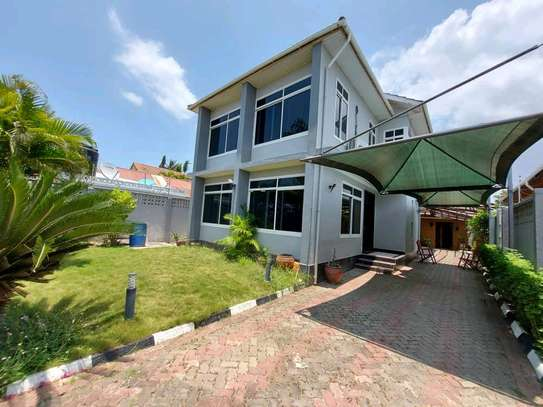 a 3bedrooms fully furnished standalone in mikocheni with a paved street image 1