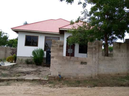 3 bed  house for sale tsh 45ml  at goba 2 km from the road, plot area sqm 400 image 4