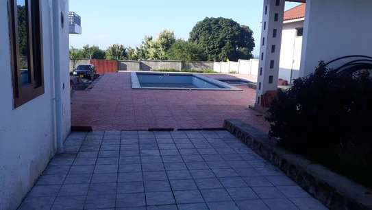 4 bed room house for sale at mapinga bagamoyo , house with big terrace and swimming pool image 3