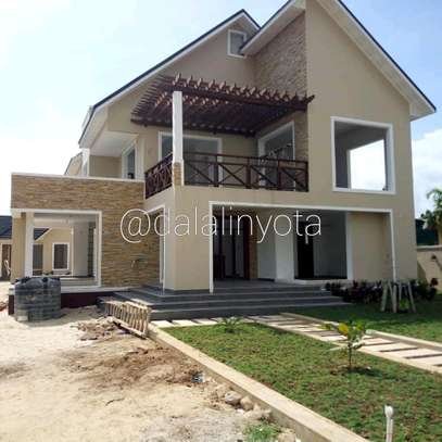 4 BDRM HOUSE AT BAHARI BEACH image 3