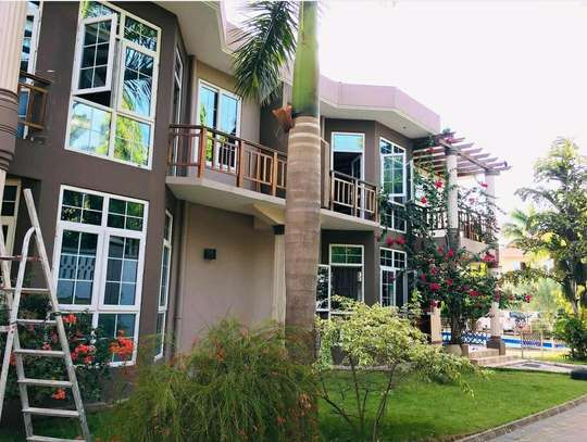 a 3bedrooms VILLAS only 2 in compound with swimming pool also close to main raod at mbezi beach is for rent image 1