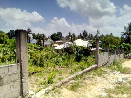 1 Acre land going cheap at Pugu Center/corner image 4