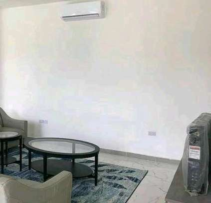 a 2bedrooms fully furnished appartments with a very decent environment at mbezi beach on paved road image 5