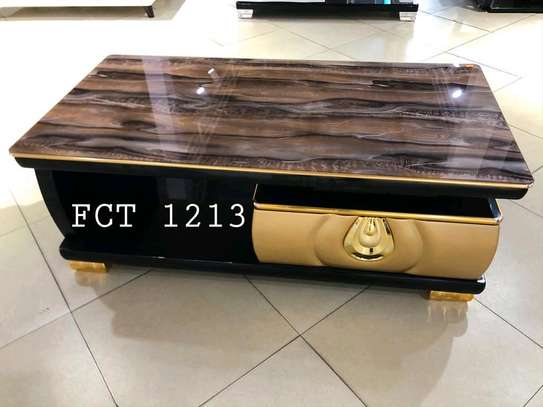 COFFEE TABLE WITH GLASS TOP...385,000/= image 1