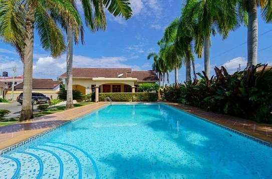 a VILLA  2bedrooms fully furnished is available for rent at mbezi beach road to whitesands hotel image 1
