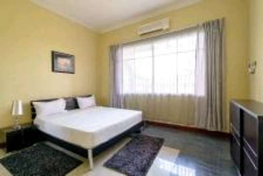 a 2bedrooms fully furnished villas in MBEZI BEACH with a very cool neighbour hood is now available for rent image 5