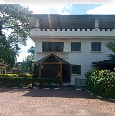 a 5bedrooms  fully furnished BUNGALOW in MBEZI BEACH walking distance to the beach is now available for rent image 1