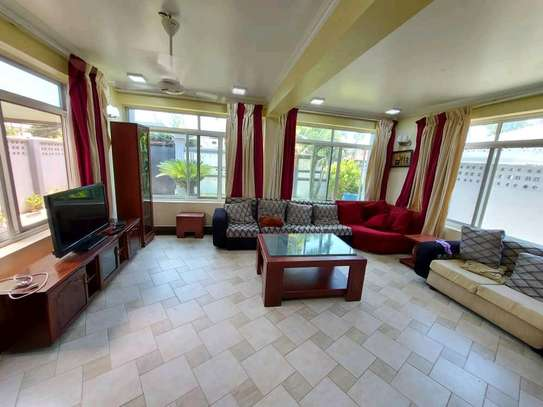 a 3bedrooms fully furnished standalone in mikocheni with a paved street image 2