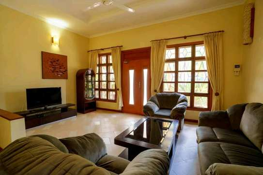 a 2bedrooms fully furnished villas in MBEZI BEACH with a very cool neighbour hood is now available for rent image 3