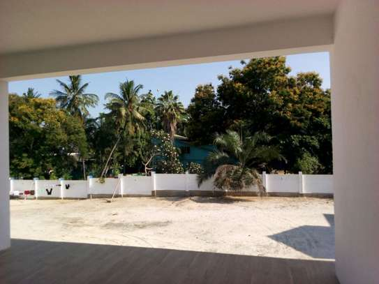4bed room ensuite at mbezi beach with big compound next to the beach $15000 image 13