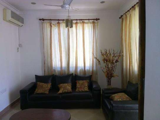 2bed furnished house at mikocheni 850000 image 5