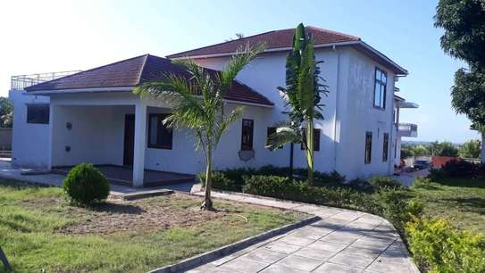 4 bed room house for sale at mapinga bagamoyo , house with big terrace and swimming pool image 1
