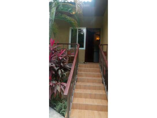 1be  fully furnished apartment at mikocheni a image 6