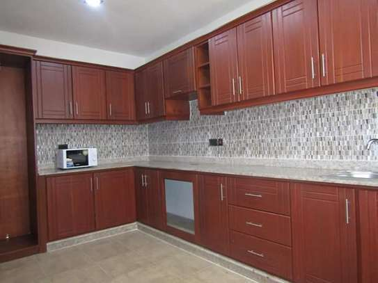 4 Bedrooms Full Furnished Villa House in Masaki image 5