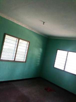 1master bedroom and seating room at ubungo image 7