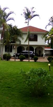 a 4bedrooms house is for sale at mbezi beach with a very cool street image 2