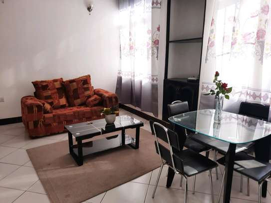 a 1bedroom fully furnished at mikocheni very close to shoppers plaza on a paved road image 2