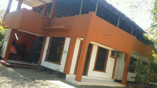 a  furnished standalone house is for rent at msasani,good street n neighbour hood