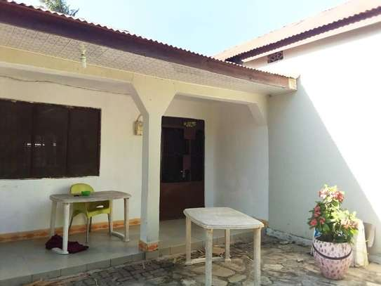 OWN 3 BEDROOMS BEAUTIFUL HOUSE AT PRIME KIGAMBONI LOCATION. image 3