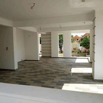 3  BDRM SEMI-FINISHED HOUSE WITH A SERVANTS' QUARTER  AT BAHARI BEACH, DAR ES SALAAM. image 8