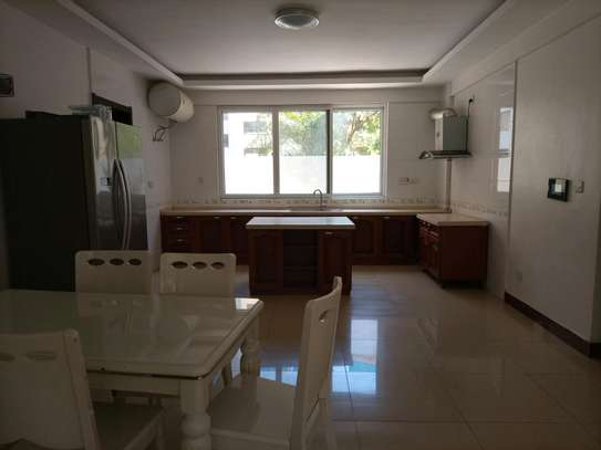 4 bedrooms fully furnished apart for rent at msasani beach image 6