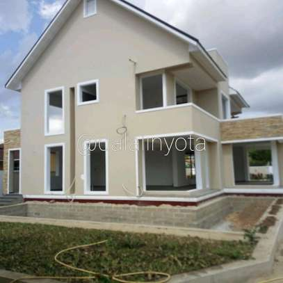 4 BDRM HOUSE AT BAHARI BEACH image 9