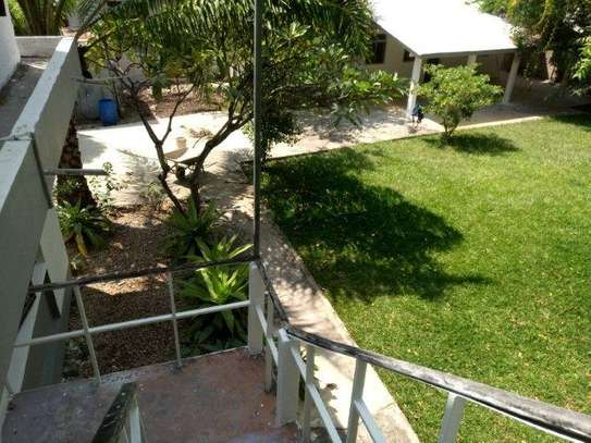 small 1bed shared house at masaki near sea cliff court tsh 600,000 image 4