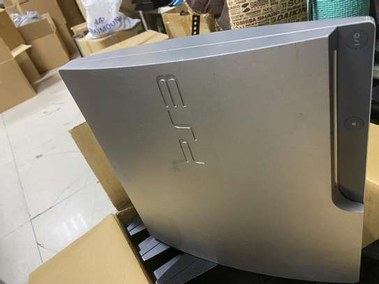 PS3 SLIM COMPLETE WITH GAMES 280,000/tsh image 1