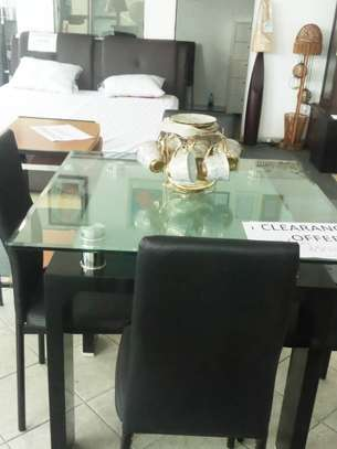 Dinning table on clearance offer. image 1