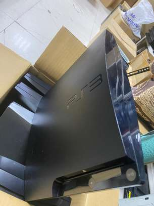 PS3 SLIM COMPLETE WITH GAMES 280,000/tsh image 4
