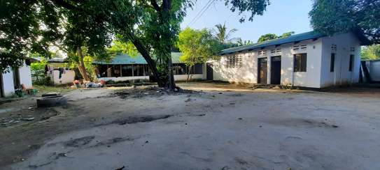 a 7huge bedrooms within 5self contained house,3units in same compound is now available for sale at MIKOCHENI easily accesible it can be residantial or for office image 8